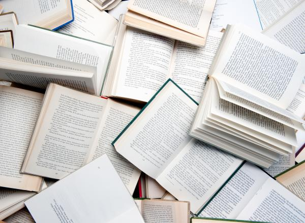 many books opened and overlapping